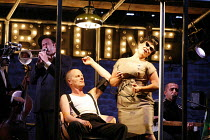 CYMBELINE   after Shakespeare   adapted and directed by Emma Rice   writer: Carl Grose,The Queen gives the King his ^medication^: Mike Shepherd (Cymbeline), Emma Rice (The Queen) with members of the b...