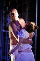 CYMBELINE   after Shakespeare   adapted and directed by Emma Rice   writer: Carl Grose,Iachimo removes the bracelet from Imogen^s wrist: Robert Luckay (Iachimo), Hayley Carmichael (Imogen),Kneehigh Th...