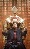 KING JOHN  by Shakespeare  design: Peter McIntosh  lighting: Neil Austin  director: Josie Rourke ~coronation - rear: John Heffernan (Bishop)   seated: Richard McCabe (King John) ~part of RSC 'The Comp...