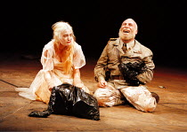 'TITUS ANDRONICUS'~Jennifer Woodburne (Lavinia), Antony Sher (Titus) with heads of Quintus & Martius in plastic sack~West Yorkshire Playhouse, Leeds, England  1995