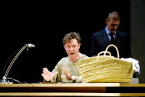 'THE WINTER'S TALE' (Shakespeare)~angry Leontes with baby daughter in basket: Alex Jennings (Leontes)~Royal National Theatre/Olivier Theatre, London SE1  23/05/2001
