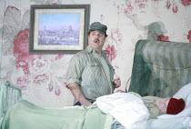 GIANNI SCHICCHI   by Puccini   conductor: Antonio Pappano   director: Richard Jones <br>,Bryn Terfel (Gianni Schicchi) with the dead Buoso Donati (Bob Smith),The Royal Opera / Covent Garden   London W...