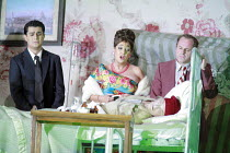 GIANNI SCHICCHI   by Puccini   conductor: Antonio Pappano   director: Richard Jones <br>,l-r: Saimir Pirgu (Rinuccio), Marie McLaughlin (La Ciesa), Christopher Purves (Marco) with the dead ^Buoso Dona...