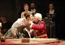 KING LEAR   by Shakespeare   director: Trevor Nunn <br>,I/i - at table: Monica Dolan (Regan),  Ian McKellen (King Lear) watched by (rear) Romola Garai (Cordelia),Royal Shakespeare Company (RSC),Courty...