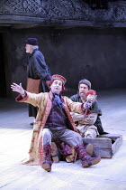 KING LEAR   by Shakespeare   director: Trevor Nunn <br>,II/iv - front, l-r: Sylvester McCoy (Lear^s Fool), Jonathan Hyde (Earl of Kent),Royal Shakespeare Company (RSC),Courtyard Theatre, Stratford-upo...