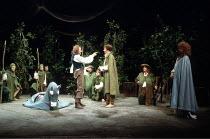 'THE TWO GENTLEMEN OF VERONA' (Shakespeare)~centre: John Franklyn-Robbins (Duke of Milan), Peter Chelsom (Valentine)   standing, right: Diana Hardcastle (Silvia)~Royal Shakespeare Company / Royal Shak...