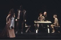 MACBETH by Shakespeare  design: Ian MacNeil  lighting: Alan Burrett  fight arranger: Malcolm Ranson  director: Adrian Noble ~IV/ii - Lady Macduff (left - Emily Richard) and her sons with their murdere...