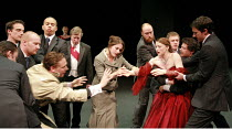CYMBELINE   by Shakespeare   director: Declan Donnellan <br>,Posthumus (front left) and Imogen (in red dress) are separated: Tom Hiddleston (Posthumus), Jodie McNee (Imogen),Cheek by Jowl / Barbican T...