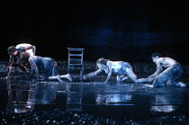 A MIDSUMMER NIGHT'S DREAM  by Shakespeare  design: Michael Levine  lighting: Jean Kalman  director: Robert Lepage   the lovers scramble through mud - l-r: Simon Coates (Demetrius), Rudi Davies (Hele...