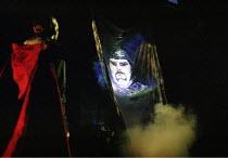 MACBETH by Shakespeare design: Bruno Santini lighting: Ben Ormerod director: James Roose-Evans ~~Macbeth (Peter Lindford) sees an apparition (projected image of head & helmet)~Ludlow Castle Open Air T...