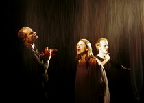 MACBETH by Shakespeare  set design: Mario Borza  lighting: Tanya Burns  costumes: Ken McDonald  director: Jude Kelly ~with water effect: (left) Patrick O'Kane (Macbeth), (centre) Mairead McKinley (Lad...