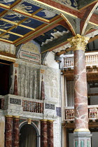 Canopy above the stage showing panels representing astrological figures ~and oak pillar rendered as Italian antico rosso marble column ~with Corinthian-style gold leaf capital  ~Shakespeare^s Globe, L...
