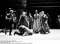 MACBETH  by Shakespeare  set design: Chris Dyer  costumes: Poppy Mitchell  lighting: Howard Eaton  director: Howard Davies ~final scene - Macbeth is dead: Bob Peck (Macbeth) overlooked by the Witches~...