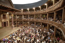 interior   showing stage, roof and audience ~during performace of UMABATHA (The Zulu Macbeth)~Shakespeare^s Globe, London SE1                   08/1997