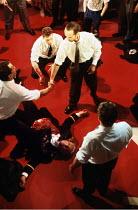 JULIUS CAESAR   by Shakespeare   design: Fran Thompson   lighting: Alan Burrett   director: David Thacker   Ceasar assassinated: David Sumner (Julius Caesar) lying on floor,standing, centre: Barry Ly...