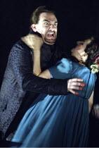 'TOSCA' (Puccini - original director: David McVicar),Tosca kills Scarpia: Stephen Kechulius (Baron Scarpia), Claire Rutter (Floria Tosca),English National Opera / London Coliseum  WC2         05/03/20...