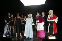 THE BLACKS (Les Negres)   by Jean Genet   translated by Robert David Macdonald   design: Ultz   directed by Ultz & Excalibah <br>,front, from centre, l-r: Tameka Empson (The Queen), Pesci (A Missionar...