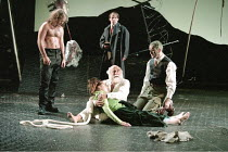 KING LEAR   by Shakespeare   design: Paul Andrews   director: Jude Kelly <br>,l-r: Robert Bowman (Edgar), (rear) Michael Cashman (Duke of Albany),,Maria Miles (Cordelia), Warren Mitchell (King Lear),...