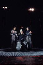 KING LEAR   by Shakespeare   design: Ellen Cairns   director: Yvonne Brewster <br>,l-r: Lolita Chakrabarti (Goneril), Ben Thomas (King Lear), Cathy Tyson (Regan),Talawa Theatre Company / Cochrane Thea...