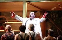 L^ELISIR D^AMORE   by Donizetti   conductor: Mikko Franck   director: Laurent Pelly <br>,Dulcamara peddles his potions: Paolo Gavanelli (Doctor Dulcamara),The Royal Opera (RO) / Covent Garden   London...