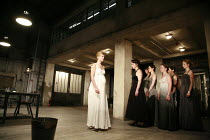 WOMEN OF TROY   by Euripides   from a version by Don Taylor   set design: Bunny Christie   costume design: Vicki Mortimer   director: Katie Mitchell <br>,centre: Anastasia Hille (Andromache) with chor...