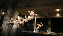 WOMEN OF TROY   by Euripides   from a version by Don Taylor   set design: Bunny Christie   costume design: Vicki Mortimer   director: Katie Mitchell <br>,Kate Duchene (Hecuba) pouring salt,Lyttelton T...