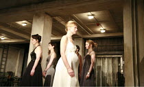WOMEN OF TROY   by Euripides   from a version by Don Taylor   set design: Bunny Christie   costume design: Vicki Mortimer   director: Katie Mitchell <br>,front centre: Anastasia Hille (Andromache) wit...