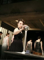 WOMEN OF TROY   by Euripides   from a version by Don Taylor   ,set design: Bunny Christie   costume design: Vicki Mortimer   director: Katie Mitchell <br>,Kate Duchene (Hecuba) pouring salt,Lyttelton...