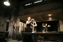 WOMEN OF TROY   by Euripides   from a version by Don Taylor   set design: Bunny Christie   costume design: Vicki Mortimer   director: Katie Mitchell <br>,front centre: Kate Duchene (Hecuba) pouring sa...