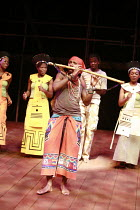 THE MAGIC FLUTE - IMPEMPE YOMLINGO   by Mozart   adapted & directed by Mark Dornford-May <br>,Mhlekazi Andy Mosiea (Tamino) and chorus,Isango/Portobello-Young Vic production / The Young Vic (YV), Lond...
