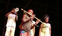 THE MAGIC FLUTE - IMPEMPE YOMLINGO   by Mozart   adapted & directed by Mark Dornford-May <br>,Mhlekazi Andy Mosiea (Tamino) with Mandisi Dyantyis rear left, playing trumpet, and chorus,Isango/Portobel...