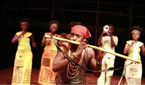 THE MAGIC FLUTE - IMPEMPE YOMLINGO   by Mozart   adapted & directed by Mark Dornford-May <br>,Mhlekazi Andy Mosiea (Tamino) with rear, playing trumpet, Mandisi Dyantyis and chorus,Isango/Portobello-Yo...