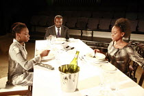 NOUGHTS & CROSSES   adapted and directed by Dominic Cooke   from the novel by Malorie Blackman   design: Kandis Cook   lighting: Wolfgang Gobbel  <br>,The Hadleys (Crosses) at dinner- l-r: Ony Uhiara...