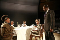 NOUGHTS & CROSSES   adapted and directed by Dominic Cooke   from the novel by Malorie Blackman   design: Kandis Cook   lighting: Wolfgang Gobbel <br>,The Hadleys (Crosses) at dinner- l-r: Jo Martin (J...