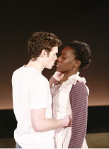 NOUGHTS & CROSSES   adapted and directed by Dominic Cooke   from the novel by Malorie Blackman   ,design: Kandis Cook   lighting: Wolfgang Gobbel <br> ,first kiss: Richard Madden (Callum), Ony Uhiara...