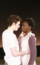 NOUGHTS & CROSSES   adapted and directed by Dominic Cooke   ,from the novel by Malorie Blackman   design: Kandis Cook   lighting: Wolfgang Gobbel <br> ,first kiss: Richard Madden (Callum), Ony Uhiara...