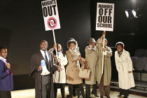 NOUGHTS & CROSSES   adapted and directed by Dominic Cooke   from the novel by Malorie Blackman   design: Kandis Cook   lighting: Wolfgang Gobbel <br> ,school protest - from left: Ony Uhiara (Sephy), T...