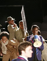 NOUGHTS & CROSSES   adapted and directed by Dominic Cooke   from the novel by Malorie Blackman   ,design: Kandis Cook   lighting: Wolfgang Gobbel <br> ,school protest - right: Ony Uhiara (Sephy),Royal...