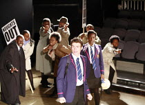 NOUGHTS & CROSSES   adapted and directed by Dominic Cooke   from the novel by Malorie Blackman   ,design: Kandis Cook   lighting: Wolfgang Gobbel <br> ,school protest - front centre: Richard Madden (C...