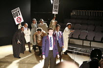 NOUGHTS & CROSSES   adapted and directed by Dominic Cooke   from the novel by Malorie Blackman   ,design: Kandis Cook   lighting: Wolfgang Gobbel <br> ,school protest - facing the police (bottom right...