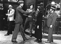 HAPPY END   music: Kurt Weill   book: Dorothy Lane   lyrics: Bertolt Brecht   director: Gordon McDougall <br>,at right: Angela Richards (Lieutenant Lillian Holliday), Bob Hoskins (Bill Cracker),Lyric...