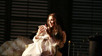LA TRAVIATA   by Verdi   conductor: Maurizio Benini   design: Bob Crowley   lighting: Jean Kalman   director: Richard Eyre <br>,Act III - ailing Violetta reads Germont^s letter: Anna Netrebko (Violett...