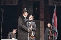 MAJOR BARBARA   by George Bernard Shaw   set design: John Gunter   costumes: Lynn Avery   director: Peter Hall <br>,l-r: Michael Pennington (Peter Shirley), Peter Bowles (Andrew Undershaft), Jemma Red...