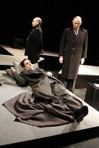 AN ENGLISH TRAGEDY   by Ronald Harwood   ,design: Ralph Koltai   director: Di Trevis <br>,l-r: Richard Goulding (John Amery), ,(rear) Bill Thomas (The Warder), Jeremy Child (Leo Amery),Watford Palace Theatre / Watford, England  18/02/2008,