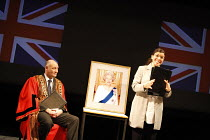 TESTING THE ECHO   by David Edgar   design: Paul Wills   director: Matthew Dunster <br>,Citizenship ceremony: Robert Gwilym (Mayor), Sirine Saba (Assistant),Out of Joint / Yvonne Arnaud Theatre, Guild...