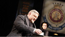 MAJOR BARBARA   by G B Shaw   set design: Tom Pye   costumes: Vicki Mortimer   director: Nicholas Hytner <br>,handing a cheque to the Salvation Army: Simon Russell Beale (Andrew Undershaft),Olivier Th...