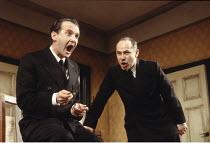 THE BIRTHDAY PARTY  by Harold Pinter  design: Tom Piper  lighting: Mark Henderson  director: Sam Mendes  ~l-r: Anton Lesser (Stanley), Nicholas Woodeson (McCann) ~Lyttelton Theatre, National Theatre (...
