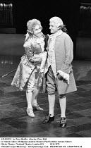 AMADEUS   by Peter Shaffer   design & lighting: John Bury  director: Peter Hall ~ ~l-r: Simon Callow (as Wolfgang Amadeus Mozart), Paul Scofield (as Antonio Salieri) ~Olivier Theatre, National Theatre...