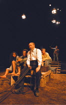 AS I LAY DYING   by William Faulkner   director: Tim Supple  ,on the road, l-r: Thusitha Jayasundera (Dewey Dell), Dan Milne (Vardaman), ,Christopher Saul (Anse Bundren), (rear, with whip) Andy Willia...