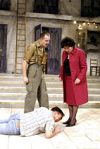 ANDORRA   by Max Frisch   adapted by Michael Bullock   design: Francis O'Connor   lighting: Paule Constable   director: Gregory Thompson <br>,l-r: Jem Wall (The Soldier), (on ground) Alec Newman (Andr...